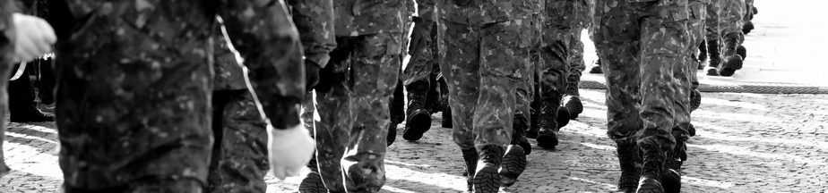 Close up photo of soldiers' feet while they ruck march