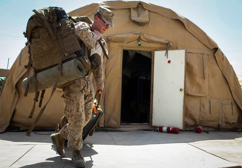 Corporal Jeffery Mount, from Hendersonville, Tennessee, team member, Security Force Assistance Advisor Team 2-215, moves his gear in preparation to leave Forward Operating Base Nolay, Helmand province, Afghanistan, May 2, 2014. Mount, along with the rest of SFAAT 2-215, are completing a seven-month deployment to the area as the last advisors in support of the 2nd Brigade, 215th Corps, Afghan National Army.