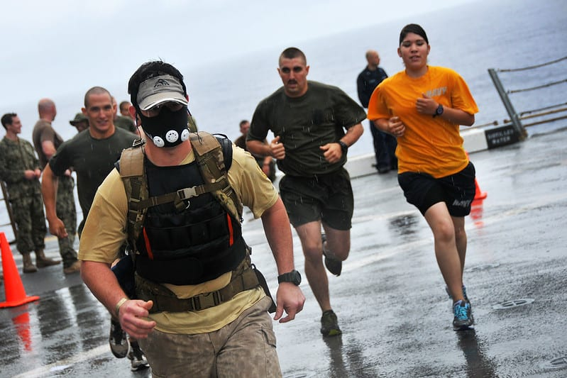 man running with a weighted vest