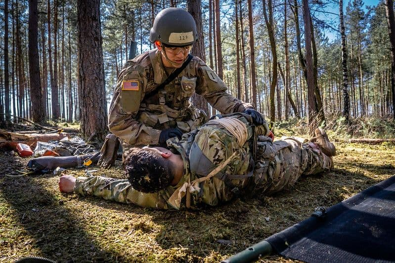 Spc. William Horne, combat medic, assigned to 1st Infantry Division treats and evacuates simulated casualties during U.S. Army Europe Expert Field Medical Badge Combat Testing Lane 3 at Grafenwoehr Training Area,