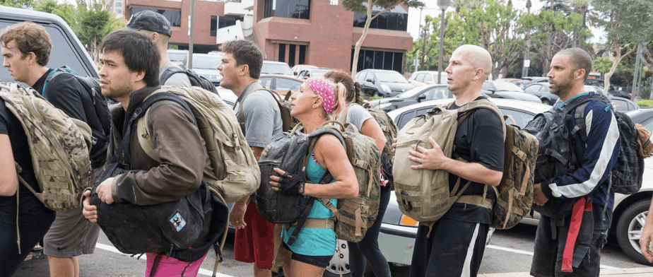 Group of people rucking in an event | Ruck Event